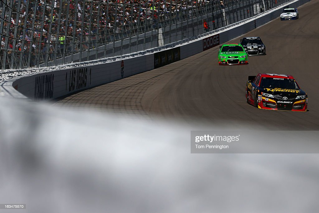 <a gi-track='captionPersonalityLinkClicked' href=/galleries/search?phrase=Clint+Bowyer&family=editorial&specificpeople=537951 ng-click='$event.stopPropagation()'>Clint Bowyer</a>, driver of the #15 5-hour ENERGY Toyota, leads a group of cars during the NASCAR Sprint Cup Series Kobalt Tools 400 at Las Vegas Motor Speedway on March 10, 2013 in Las Vegas, Nevada.