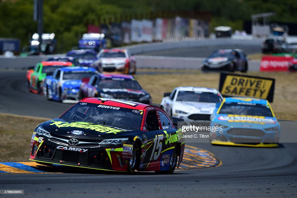 Clint Bowyer driver of the 5Hour Energy Toyota leads a pack of cars during the NASCAR Sprint Cup Series Toyota/Save Mart 350 at Sonoma Raceway on...