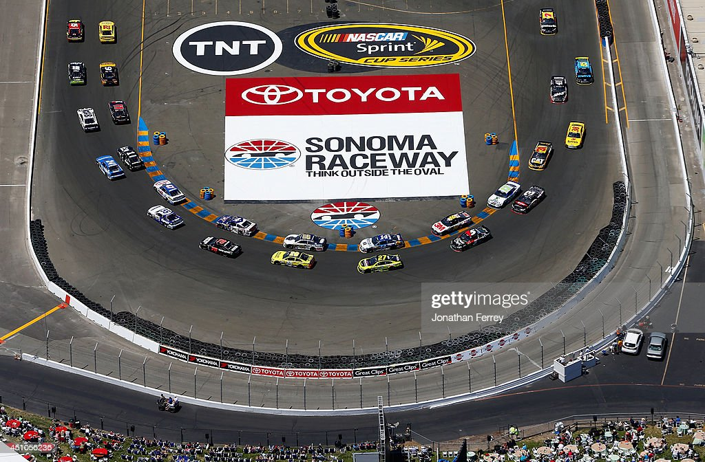 Clint Bowyer driver of the 5hour ENERGY Toyota leads Joey Logano driver of the ShellPennzoil Ford on a restart during the NASCAR Sprint Cup Series...