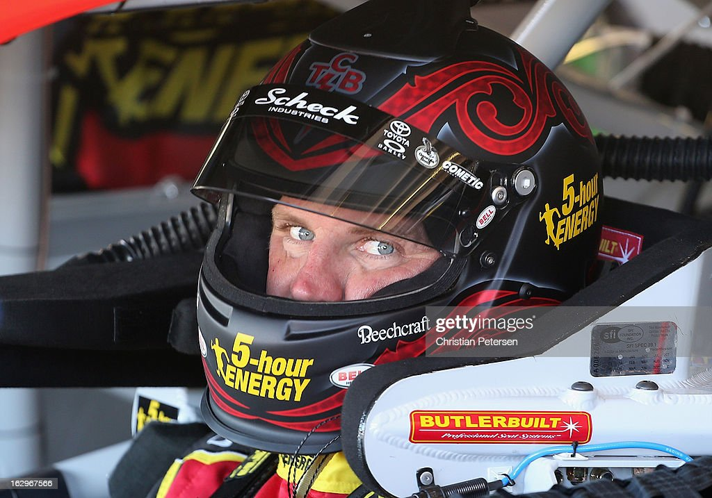 <a gi-track='captionPersonalityLinkClicked' href=/galleries/search?phrase=Clint+Bowyer&family=editorial&specificpeople=537951 ng-click='$event.stopPropagation()'>Clint Bowyer</a>, driver of the #15 5-hour ENERGY Toyota, looks on from his car in the garage during practice for the NASCAR Sprint Cup Series Fresh Fit 500 at Phoenix International Raceway on March 2, 2013 in Avondale, Arizona.