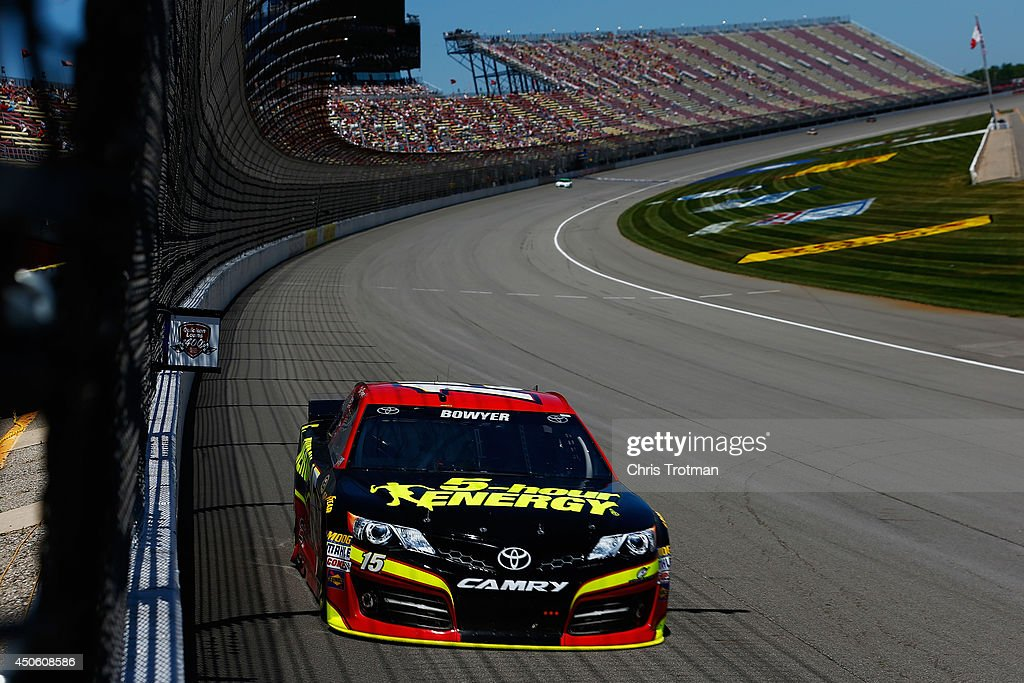 Clint Bowyer, driver of the #15 5-hour ENERGY Toyota, practices for the NASCAR Sprint Cup Series Quicken Loans 400 at Michigan International Speedway on June 14, 2014 in Brooklyn, Michigan.