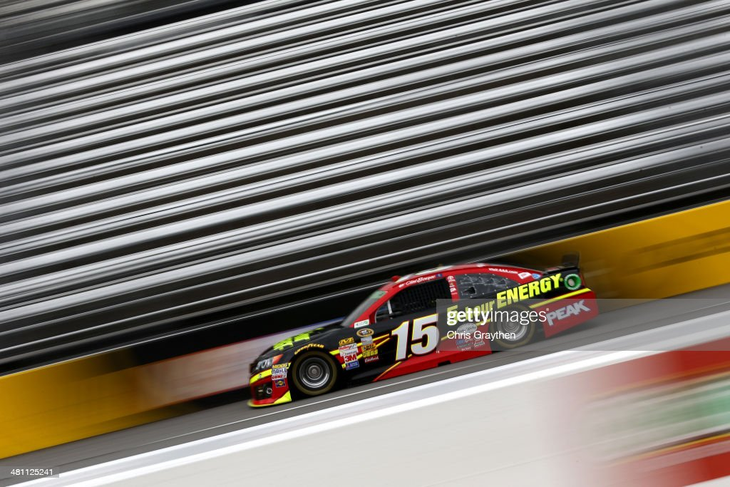 Clint Bowyer driver of the 5hour ENERGY Toyota practices for the NASCAR Sprint Cup Series STP 500 at Martinsville Speedway on March 28 2014 in...