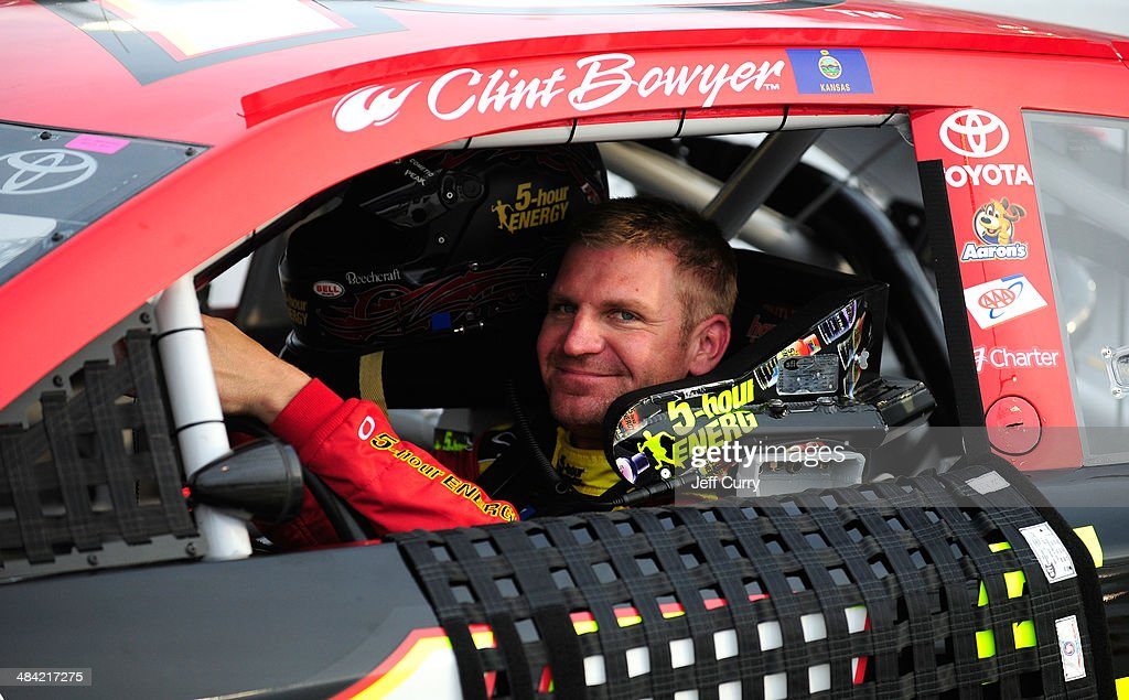 <a gi-track='captionPersonalityLinkClicked' href=/galleries/search?phrase=Clint+Bowyer&family=editorial&specificpeople=537951 ng-click='$event.stopPropagation()'>Clint Bowyer</a>, driver of the #15 5-hour Energy Toyota, sits in his car during qualifying for the NASCAR Sprint Cup Series Bojangles' Southern 500 at Darlington Raceway on April 11, 2014 in Darlington, South Carolina.