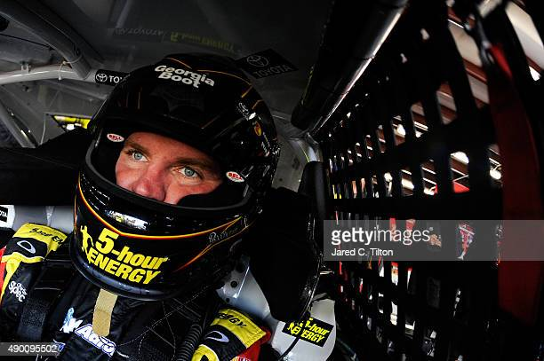Clint Bowyer driver of the 5Hour Energy Toyota sits in his car during practice for the NASCAR Sprint Cup Series Sylvania 300 at New Hampshire Motor...