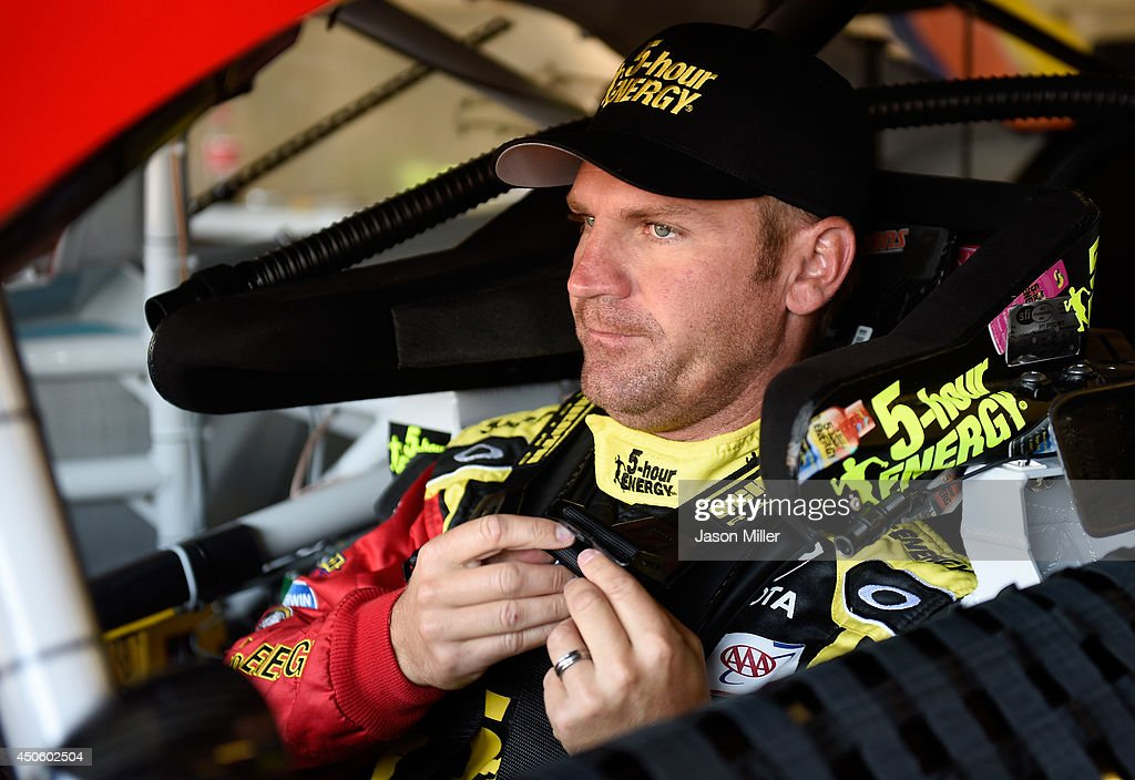 Clint Bowyer, driver of the #15 5-hour ENERGY Toyota, sits in his car in the garage area during practice for the NASCAR Sprint Cup Series Quicken Loans 400 at Michigan International Speedway on June 14, 2014 in Brooklyn, Michigan.