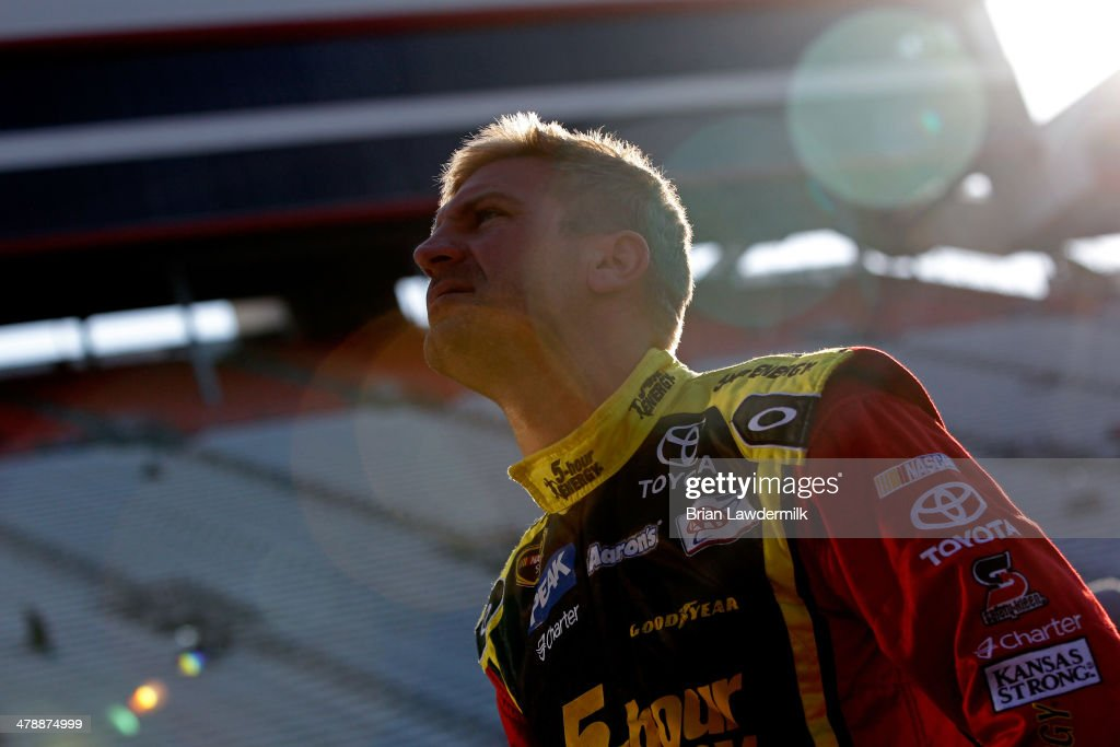 Clint Bowyer driver of the 5hour ENERGY Toyota stands in the garage area during practice for the NASCAR Sprint Cup Series Food City 500 at Bristol...