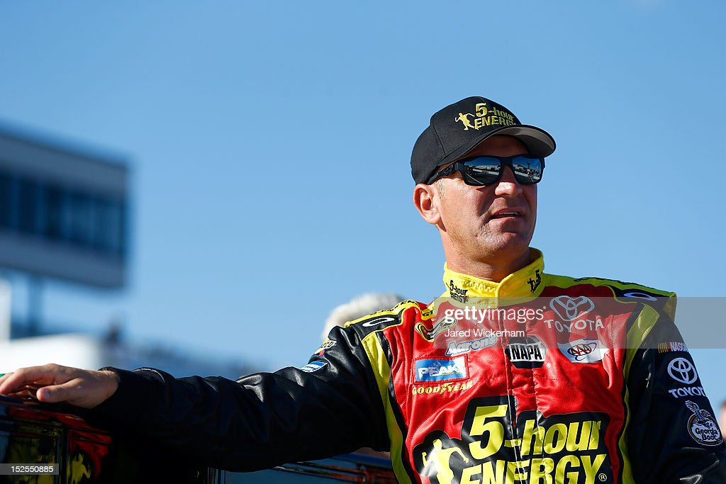 <a gi-track='captionPersonalityLinkClicked' href=/galleries/search?phrase=Clint+Bowyer&family=editorial&specificpeople=537951 ng-click='$event.stopPropagation()'>Clint Bowyer</a>, driver of the #15 5-hour Energy Toyota, stands on pit road during qualifying for the NASCAR Sprint Cup Series Sylvania 300 at New Hampshire Motor Speedway on September 21, 2012 in Loudon, New Hampshire.