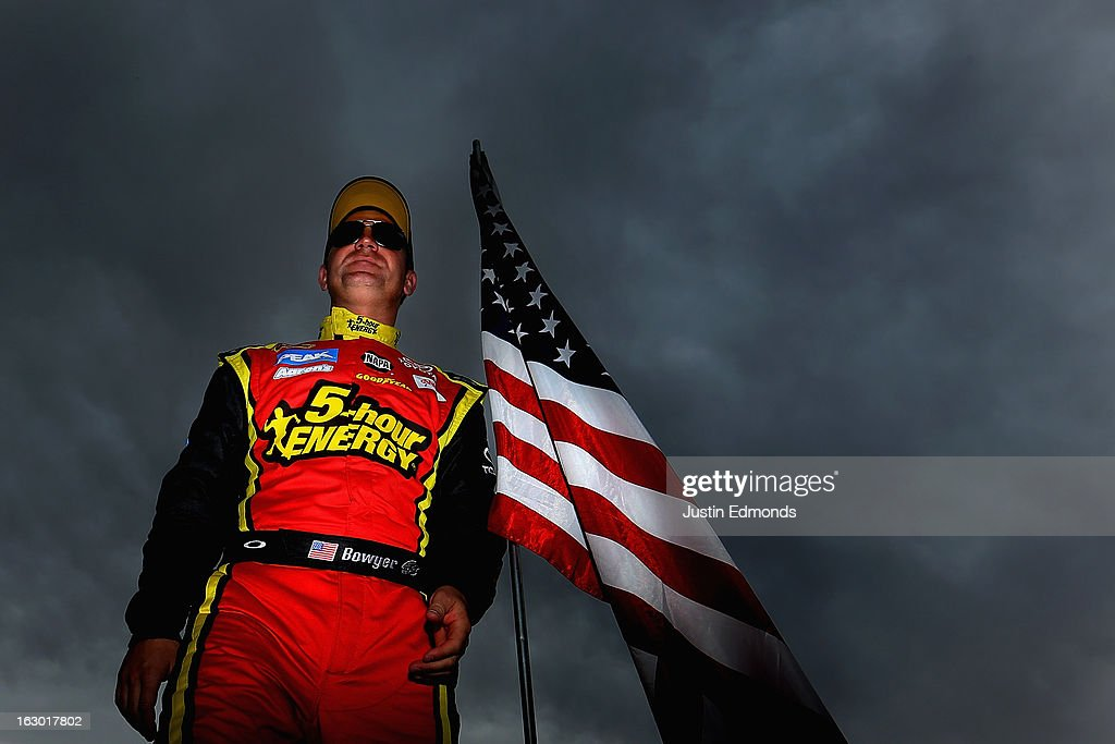 Clint Bowyer, driver of the #15 5-hour ENERGY Toyota, stands on pit road before the NASCAR Sprint Cup Series Subway Fresh Fit 500 at Phoenix International Raceway on March 3, 2013 in Avondale, Arizona.