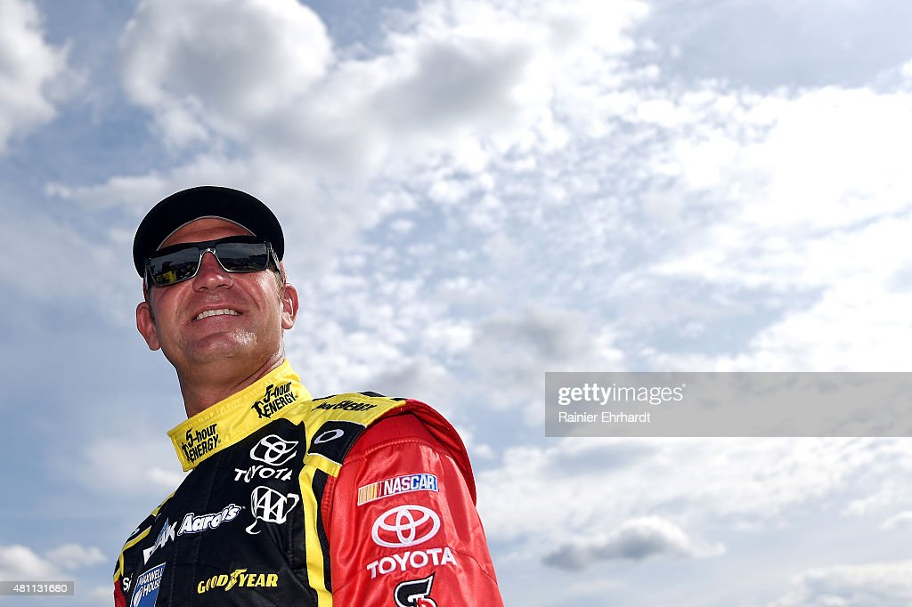<a gi-track='captionPersonalityLinkClicked' href=/galleries/search?phrase=Clint+Bowyer&family=editorial&specificpeople=537951 ng-click='$event.stopPropagation()'>Clint Bowyer</a>, driver of the #15 5-Hour Energy Toyota, stands on the grid during qualifying for the NASCAR Sprint Cup Series 5-Hour Energy 301 at New Hampshire Motor Speedway on July 17, 2015 in Loudon, New Hampshire.