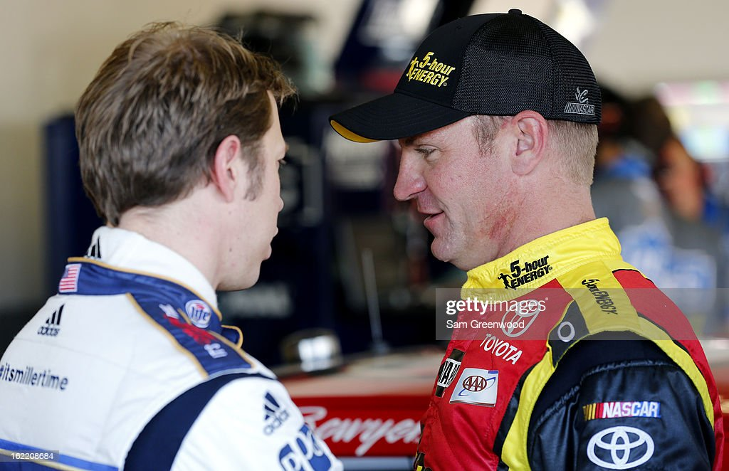 Clint Bowyer (R), driver of the #15 5-hour ENERGY Toyota, talks with Brad Keselowski (L), driver of the #2 Miller Lite Ford, during practice for the NASCAR Sprint Cup Series Daytona 500 at Daytona International Speedway on February 20, 2013 in Daytona Beach, Florida.