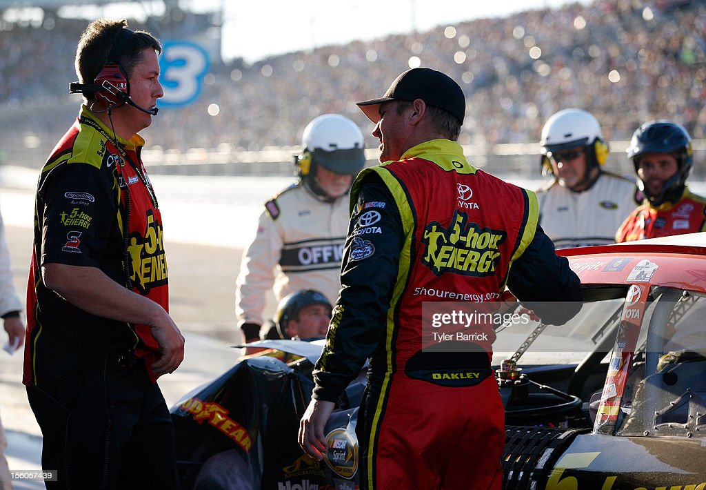 Clint Bowyer (R), driver of the #15 5-hour Energy Toyota, talks with crew chief Brian Pattie (L) on pit road after an incident with Jeff Gordon (not pictured), driver of the #24 DuPont Chevrolet, during the NASCAR Sprint Cup Series AdvoCare 500 at Phoenix International Raceway on November 11, 2012 in Avondale, Arizona.