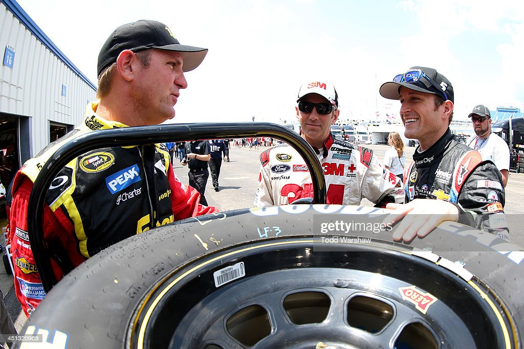 Clint Bowyer, driver of the #15 5-hour ENERGY Toyota, talks with Greg Biffle, driver of the #16 3M ACE Bandage Ford, and Kasey Kahne, driver of the #5 Farmers Insurance Chevrolet, during practice for the NASCAR Sprint Cup Series Quaker State 400 presented by Advance Auto Parts at Kentucky Speedway on June 27, 2014 in Sparta, Kentucky.