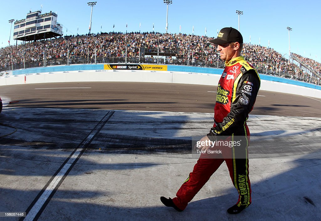 Clint Bowyer, driver of the #15 5-hour Energy Toyota, walks back to his car on pit road after an incident with Jeff Gordon (not pictured), driver of the #24 DuPont Chevrolet, during the NASCAR Sprint Cup Series AdvoCare 500 at Phoenix International Raceway on November 11, 2012 in Avondale, Arizona.