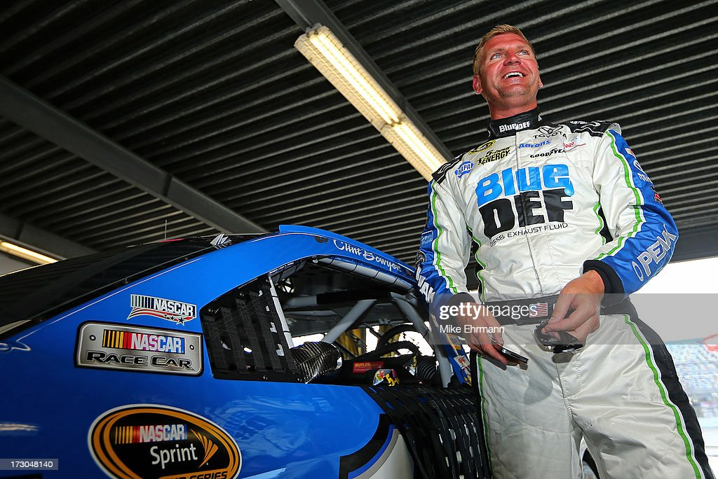 <a gi-track='captionPersonalityLinkClicked' href=/galleries/search?phrase=Clint+Bowyer&family=editorial&specificpeople=537951 ng-click='$event.stopPropagation()'>Clint Bowyer</a>, driver of the #15 Blue DEF Diesel Exhaust Fluid Toyota, looks on during qualifying for the NASCAR Sprint Cup Series Coke Zero 400 at Daytona International Speedway on July 5, 2013 in Daytona Beach, Florida.