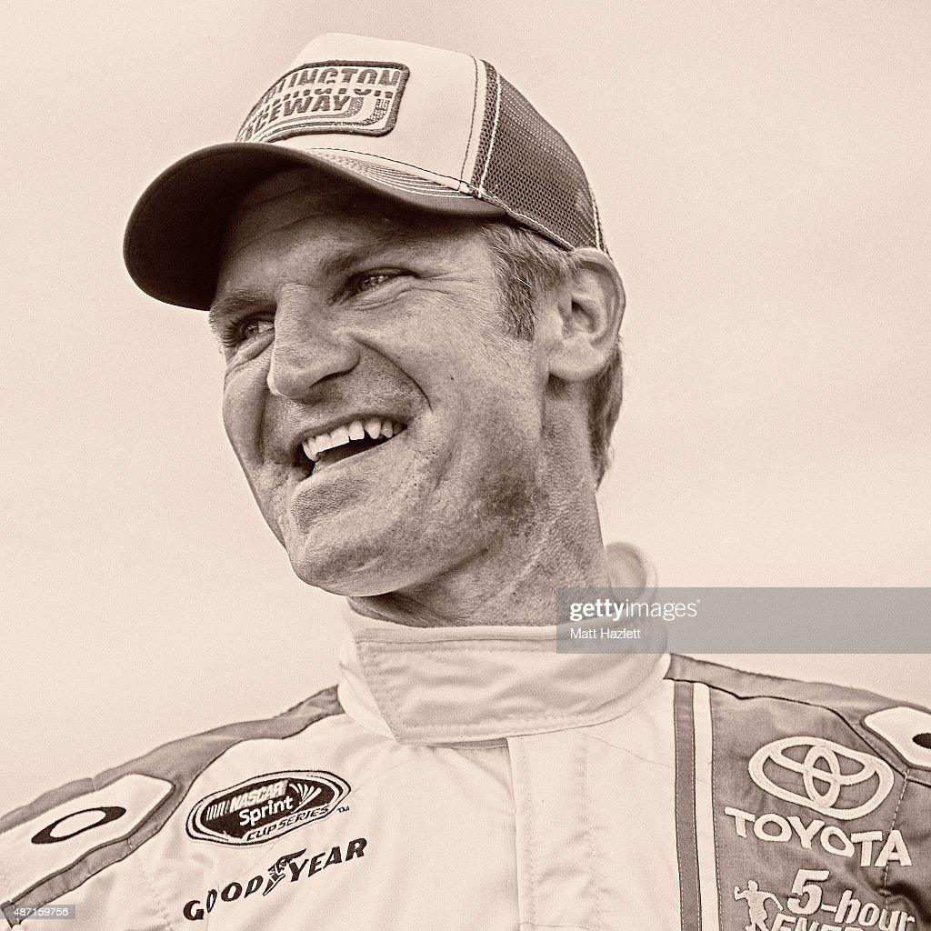 Clint Bowyer driver of the Buddy Baker Tribute Toyota looks on prior to the NASCAR Sprint Cup Series Bojangles' Southern 500 at Darlington Raceway on...