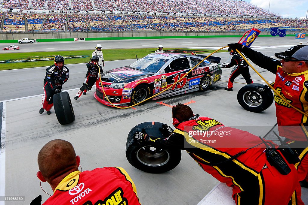 Clint Bowyer, driver of the #15 Camry 30th Anniversary Toyota, pits during the NASCAR Sprint Cup Series Quaker State 400 at Kentucky Speedway on June 30, 2013 in Sparta, Kentucky.