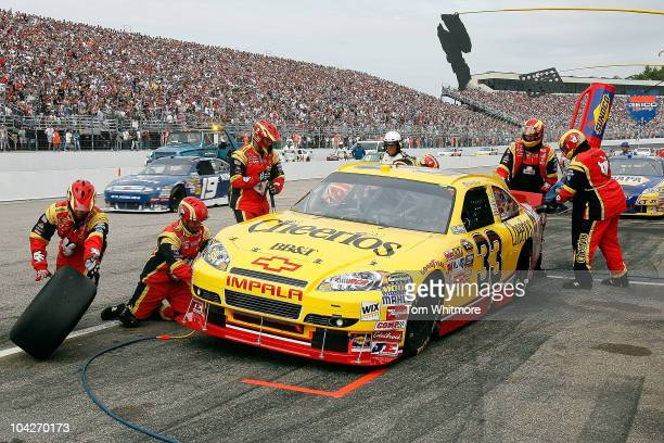 Clint Bowyer driver of the Cheerios / Hamburger Helper Chevrolet pits during the NASCAR Sprint Cup Series Sylvania 300 at New Hampshire Motor...