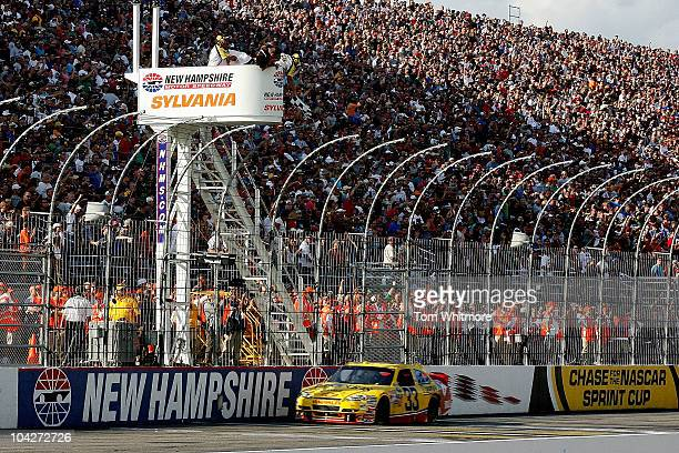 Clint Bowyer driver of the Cheerios / Hamburger Helper Chevrolet crosses the start / finish line to take the checkered flag and win the NASCAR Sprint...