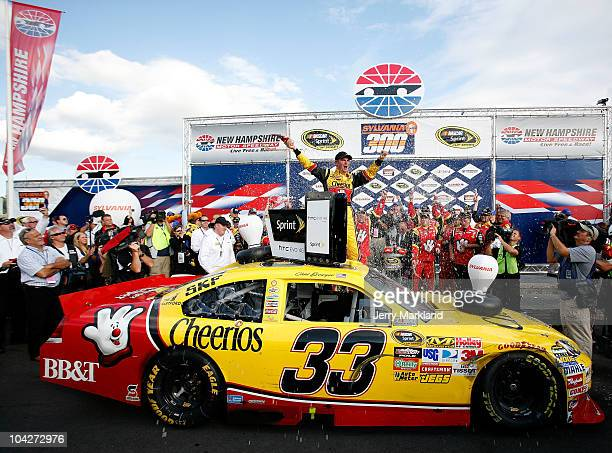 Clint Bowyer driver of the Cheerios / Hamburger Helper Chevrolet celebrates with his crew in victory lane after he won the NASCAR Sprint Cup Series...
