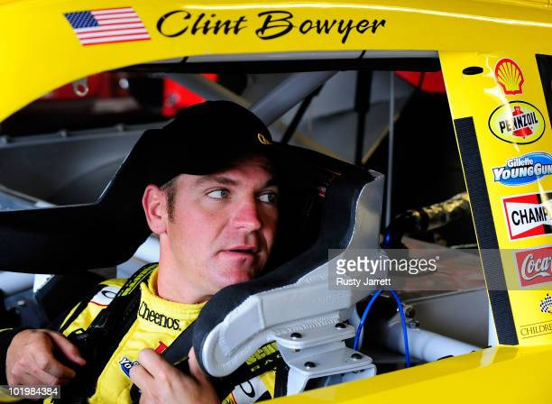 Clint Bowyer driver of the Cheerios/Hamburger Helper Chevrolet sits in his car prior to practice for the NASCAR Sprint Cup Series Heluva Good Sour...