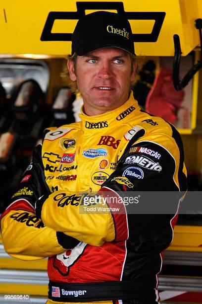 Clint Bowyer driver of the Cheerios/Hamburger Helper Chevrolet stands in the garage during practice for the NASCAR Sprint Cup Series Autism Speaks...