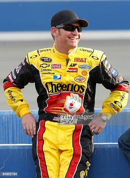 Clint Bowyer driver of the Cheerios/Hamburger Helper Chevrolet watches during qualifying for the NASCAR Sprint Cup Series Auto Club 500 at Auto Club...
