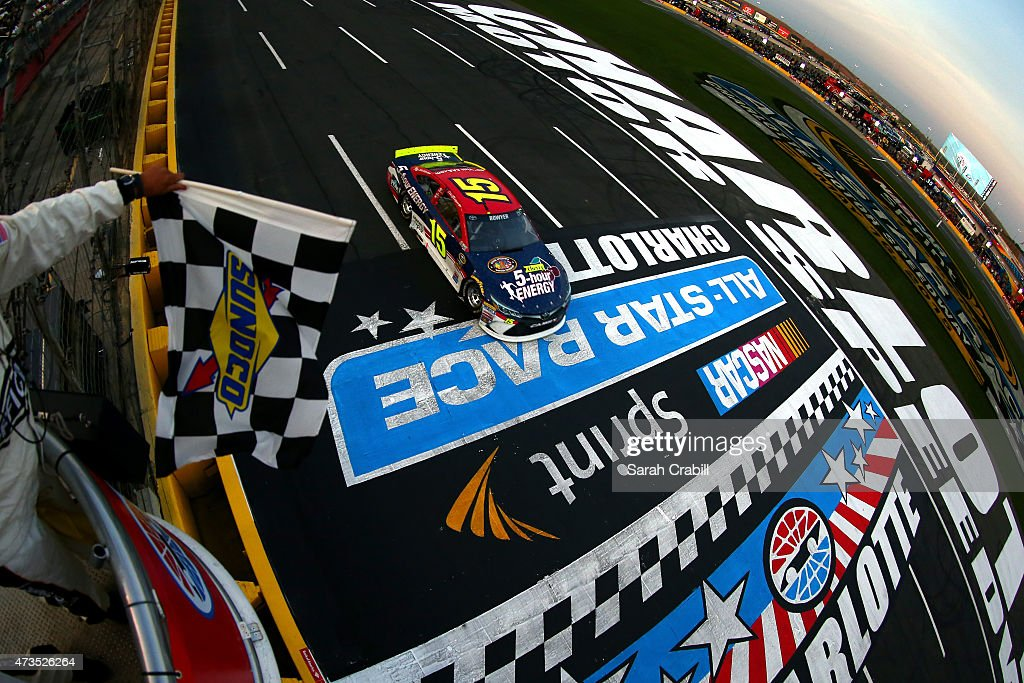 Clint Bowyer driver of the Cherry 5Hour Energy/Special Operations Warrior Foundation Toyota takes the checkered flag to win the second round of the...
