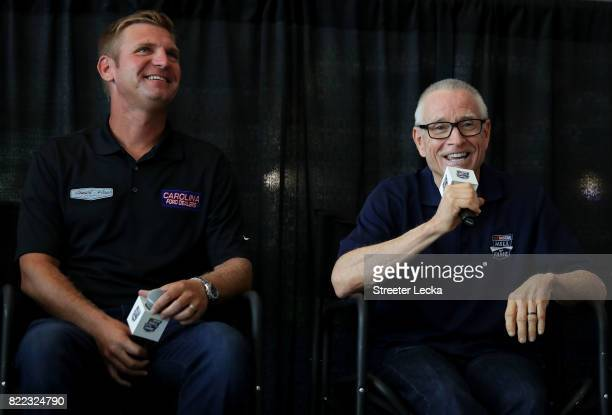 Clint Bowyer driver of the Ford Fusion for StewartHaas Racing and Mark Martin NASCAR Hall of Famer speak to the crowd during the Darlington Throwback...