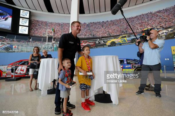 Clint Bowyer driver of the Ford Fusion for StewartHaas Racing poses for pictures with fans during the Darlington Throwback Paint Scheme Unveil at...