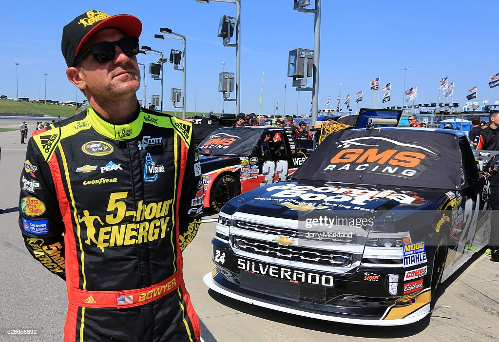 Clint Bowyer, driver of the #24 Georgia Boot/5-Hour Energy/Visine Chevrolet, looks on during qualifying for the NASCAR Camping World Truck Series Toyota Tundra 250 at Kansas Speedway on May 6, 2016 in Kansas City, Kansas.