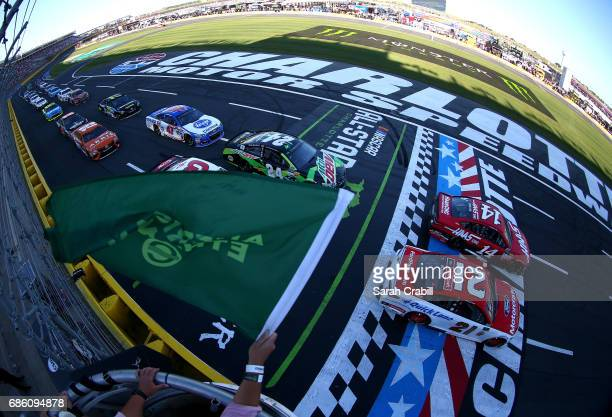 Clint Bowyer driver of the Haas Automation Ford and Ryan Blaney driver of the Motorcraft/Quick Lane Tire Auto Center Ford take the green flag to...