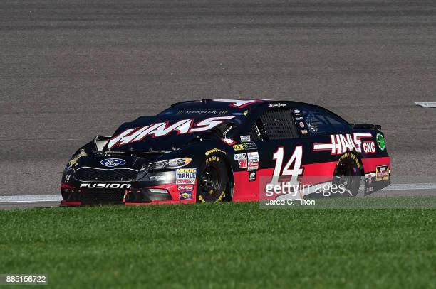 Clint Bowyer driver of the Haas Automation Ford is involved in an ontrack incident during the Monster Energy NASCAR Cup Series Hollywood Casino 400...