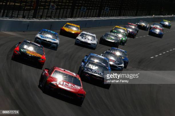 Clint Bowyer driver of the Haas Automation Ford leads a pack of cars during the Monster Energy NASCAR Cup Series O'Reilly Auto Parts 500 at Texas...