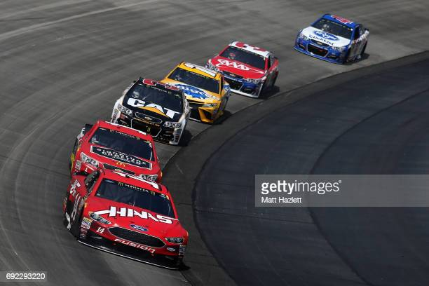 Clint Bowyer driver of the Haas Automation Ford leads a pack of cars during the Monster Energy NASCAR Cup Series AAA 400 Drive for Autism at Dover...