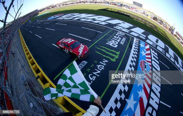 Clint Bowyer driver of the Haas Automation Ford takes the checkered flag to win Stage 1 of the Monster Energy NASCAR Open at Charlotte Motor Speedway...