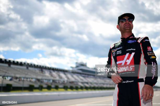 Clint Bowyer driver of the Haas Automation Ford walks down pit road during qualifying for the Monster Energy NASCAR Cup Series Axalta presents the...