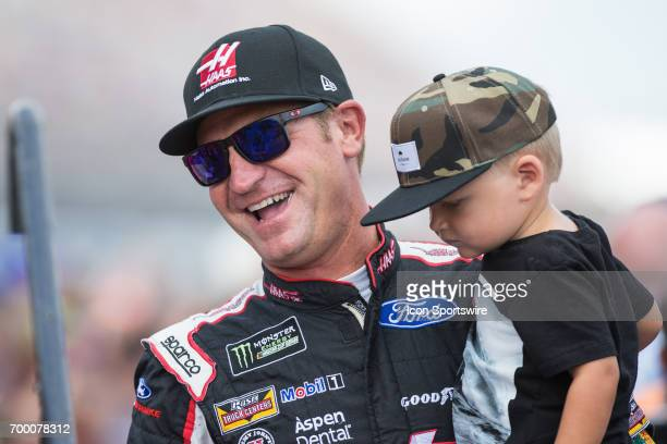 Clint Bowyer driver of the HaasAutomation Ford greets fans during the driver introductions ceremony prior to the start of the Monster Energy Cup...