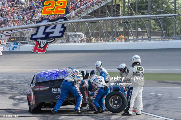 Clint Bowyer driver of the HaasAutomation Ford makes a pit stop during the Monster Energy Cup Series Firekeepers Casino 400 race on June 18 2017 at...