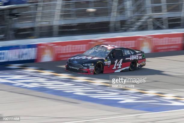 Clint Bowyer driver of the HaasAutomation Ford races during the Monster Energy Cup Series Firekeepers Casino 400 race on June 18 2017 at Michigan...