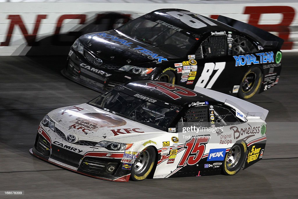 Clint Bowyer, driver of the #15 KFC iatethebones Toyota, races Joe Nemechek, driver of the #87 RoyalTeakCollection.com Toyota, during the NASCAR Sprint Cup Series Bojangles' Southern 500 at Darlington Raceway on May 11, 2013 in Darlington, South Carolina.