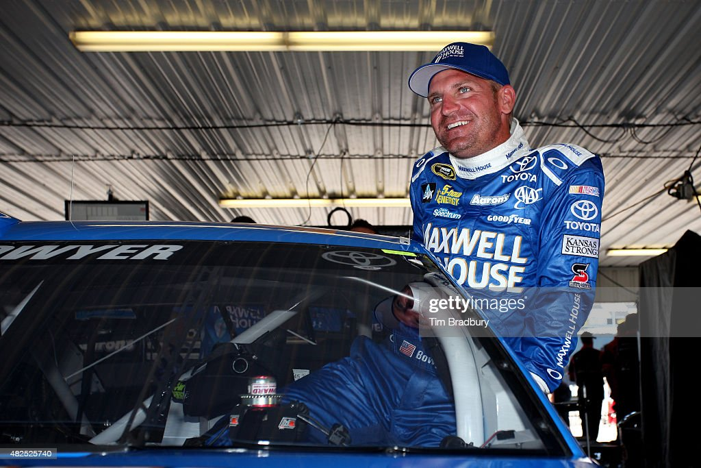<a gi-track='captionPersonalityLinkClicked' href=/galleries/search?phrase=Clint+Bowyer&family=editorial&specificpeople=537951 ng-click='$event.stopPropagation()'>Clint Bowyer</a>, driver of the #15 Maxwell House Toyota, gets in his car in the garage during practice for the NASCAR Sprint Cup Series Windows 10 400 at Pocono Raceway on July 31, 2015 in Long Pond, Pennsylvania.