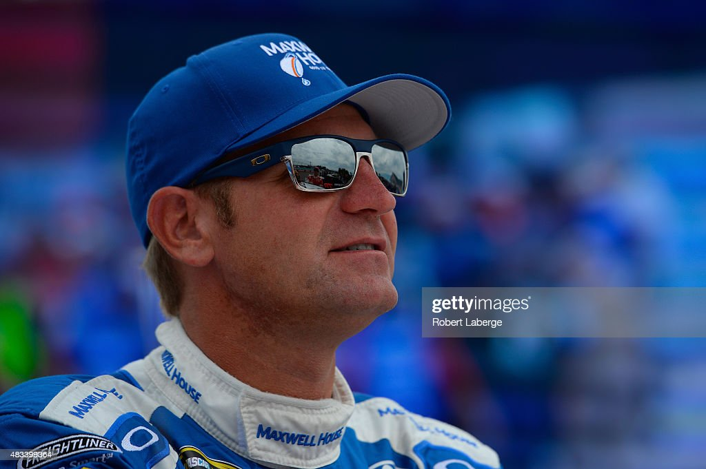 <a gi-track='captionPersonalityLinkClicked' href=/galleries/search?phrase=Clint+Bowyer&family=editorial&specificpeople=537951 ng-click='$event.stopPropagation()'>Clint Bowyer</a>, driver of the #15 Maxwell House Toyota, stands on the grid during qualifying for the NASCAR Sprint Cup Series Cheez-It 355 at Watkins Glen International on August 8, 2015 in Watkins Glen, New York.