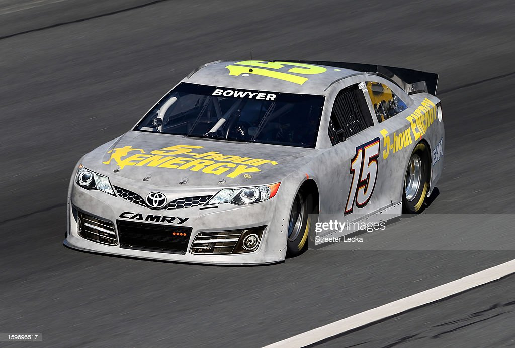 Clint Bowyer, driver of the #15 Michael Waltrip Racing Toyota, in action during NASCAR Testing at Charlotte Motor Speedway on January 18, 2013 in Charlotte, North Carolina.