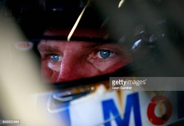 Clint Bowyer driver of the Mobil 1 Ford sits in his car during practice for the 59th Annual DAYTONA 500 at Daytona International Speedway on February...