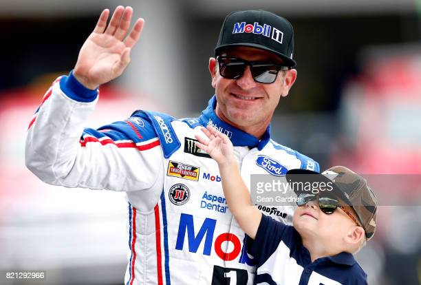 Clint Bowyer driver of the Mobil 1/Rush Truck Centers Ford and his son Cash are introduced prior to the Monster Energy NASCAR Cup Series Brickyard...