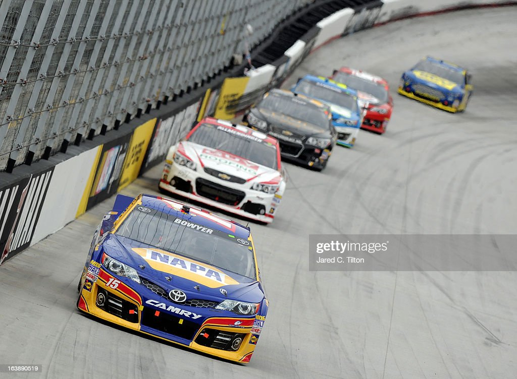 Clint Bowyer, driver of the #15 NAPA Filters Toyota, leads a group cars during the NASCAR Sprint Cup Series Food City 500 at Bristol Motor Speedway on March 17, 2013 in Bristol, Tennessee.