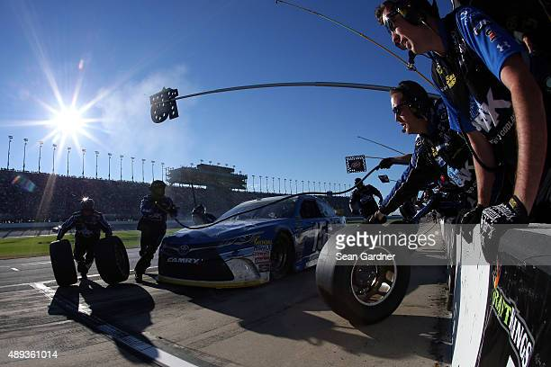 Clint Bowyer driver of the PEAK Antifreeze Coolant Toyota pits during the NASCAR Sprint Cup Series myAFibRiskcom 400 at Chicagoland Speedway on...