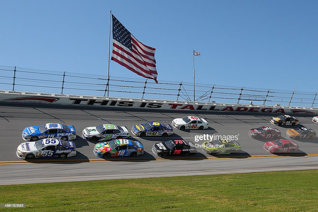 Clint Bowyer, driver of the #15 PEAK Antifreeze / Motor Oil Toyota, and Brian Vickers, driver of the #55 Aaron's Dream Machine Toyota, lead a pack of cars during the NASCAR Sprint Cup Series Aaron's 499 at Talladega Superspeedway on May 4, 2014 in Talladega, Alabama.