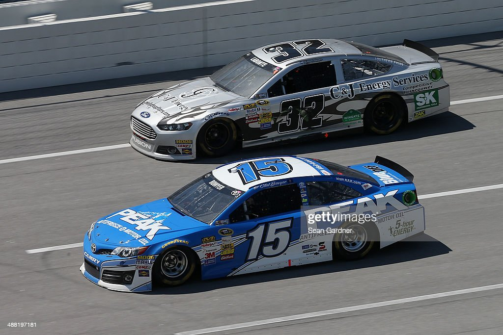 Clint Bowyer, driver of the #15 PEAK Antifreeze / Motor Oil Toyota, leads Terry Labonte, driver of the #32 C&J Energy Services Ford, during the NASCAR Sprint Cup Series Aaron's 499 at Talladega Superspeedway on May 4, 2014 in Talladega, Alabama.