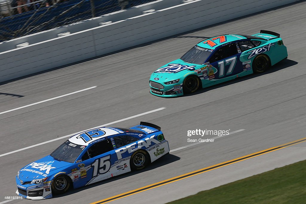 Clint Bowyer, driver of the #15 PEAK Antifreeze / Motor Oil Toyota, leads Ricky Stenhouse Jr., driver of the #17 Zest Ford, during the NASCAR Sprint Cup Series Aaron's 499 at Talladega Superspeedway on May 4, 2014 in Talladega, Alabama.